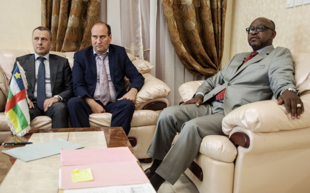 (LtoR) First Secretary at the Russian Embassy in the Central African Republic Victor Tokmakov, Special Security Advisor to the Central African President Valeriy Zakharov and Minister of Communication and Government Spokesman Ange Maxime Kazagui, meet in the office of the administrative building, on August 2, 2018 in Bangui. - Russia on August 2, 2018 said no sign of torture was found on the bodies of three Russian journalists killed during a reporting trip in the Central African Republic this week. Journalists Kirill Radchenko, Alexadner Rastorguyev and Orkhan Dzhemal were killed in the strife-torn African country on July 30, 2018. They were reporting on the so-called Wagner Group, a company that sends Russian mercenaries to hotspots such as Syria and Ukraine that has been described as Moscow's shadow army.