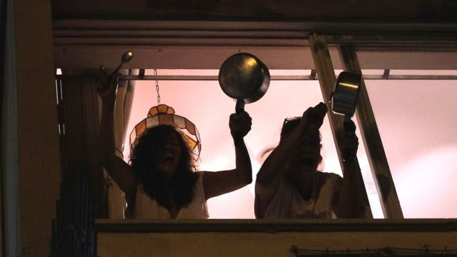 Coronavirus protest in Brazil sees millions bang pots from balconies - BBC  News