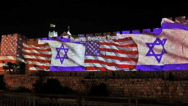 The Israeli and United States flags are projected on the walls of the ramparts of Jerusalem's Old City, to mark the opening of the new US embassy