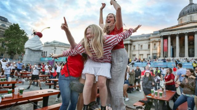 Fans celebrate in London during the European Cup