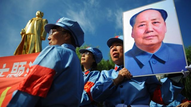 People with poster of Mao Zedong