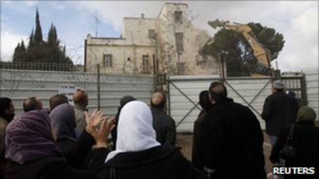 Palestinians watch as the Hotel Shepherd is torn down, East Jerusalem (9 Jan 2011)