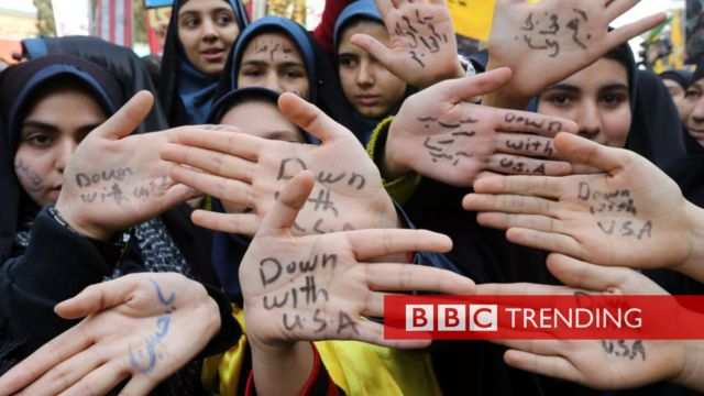The Iranians writing 'Down with USA' on their hands