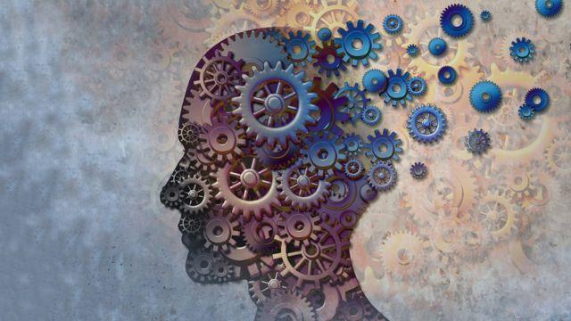 Ilustración de una cabeza de perfil con un sistema de engranajes interno