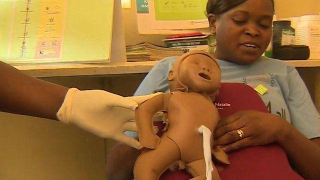 Nurse with MamaNatalie birth simulator