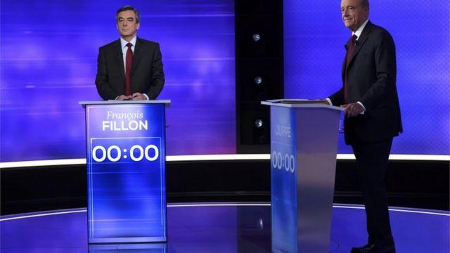 فيون (إلى اليسار) وجوبيه في مناظرتهما التلفزيونية
