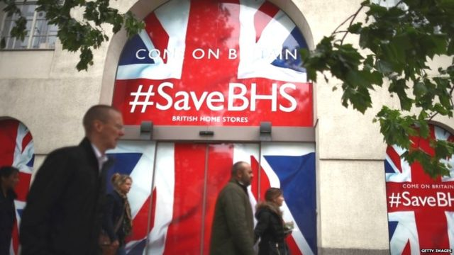 People walk past the headquarters of British Home Stores on 2 June 2016 in London