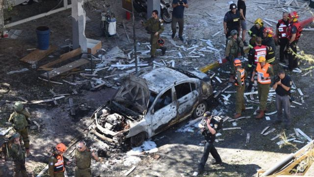 Police and rescue teams at the scene of a direct rocket hit in Ramat Gan, Israel, 15 May 2021