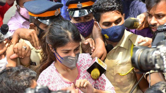 Rhea Chakraborty surrounded by media