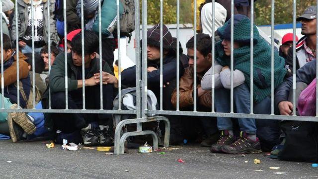 Migrants wait at Sentilj on the Slovenian Austrian border