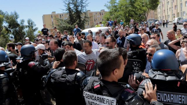 Protesters push up against police in Bastia, Corsica, 14 August