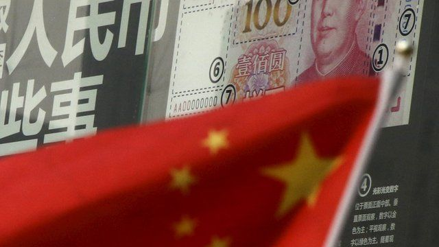 Chinese flag in front of bank note