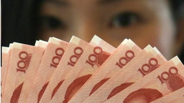 Mainland China 100 Yuan notes are at a Bank of China in Hong Kong 12 January 2007.