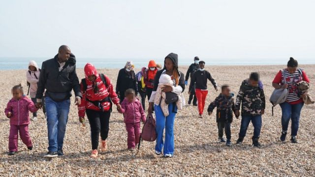 Adults and children on the beach