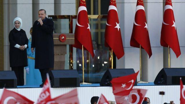 Turkish President Tayyip Erdogan with his wife Emine addresses supporters in Ankara