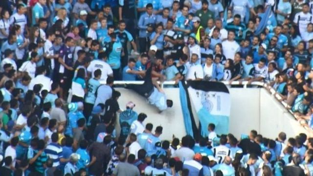 Emanuel Balbo (centre) was pushed over the edge of a stand on Saturday
