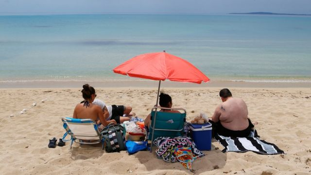 Holidaymakers on a beach in Mallorca