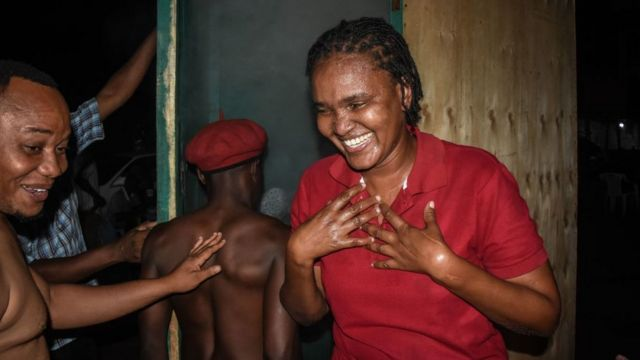 A woman reacts as a customer enters a steam inhalation booth in Dar es Salaam, Tanzania, on May 22, 2020