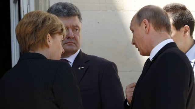 Лідери Німечини, України та Росії - архівне фото червень 2014 року.