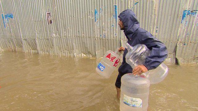 Man walking through flooded street in Chennai