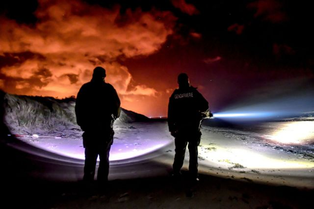 Gendarmes on the beach at Oye-Plage, near Calais