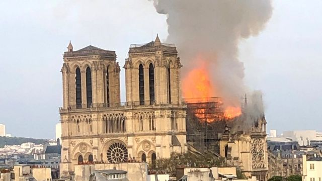 Flames billow from Notre-Dame cathedral in Paris
