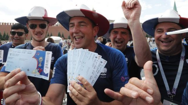 France fans show off tickets to the World Cup final