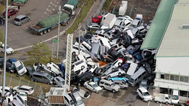 An aerial picture shows cars pilled up a day after powerful Typhoon Jebi hit the area in Kobe, western Japan