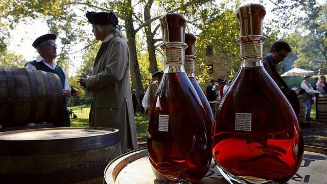 Actors dressed in period costumes gather behind freshly produced whiskey prior to the dedication ceremony for the George Washington Distillery in Mount Vernon, Virginia.
