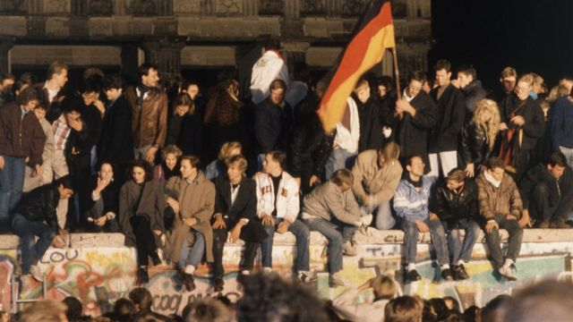 Revellers celebrate the opening of the Berlin Wall