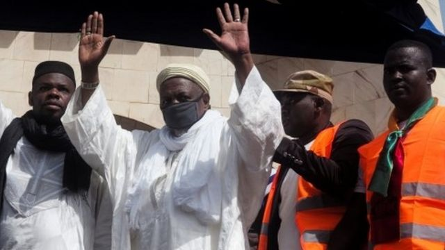 "Imam Mahmoud Dicko greets his supporters during a protest demanding the resignation of Mali""s President Ibrahim Boubacar Keita at Independence Square in Bamako, Mali June 19, 2020"