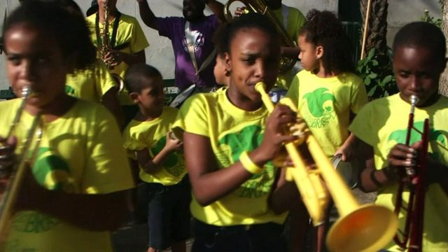 Children playing in band in favela in Rio