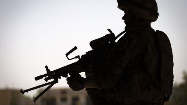 Mali Soldier dey pose with gun