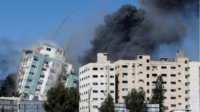 Gaza tower housing media organisations and apartments collapses after a strike in Gaza city, May 15, 2021