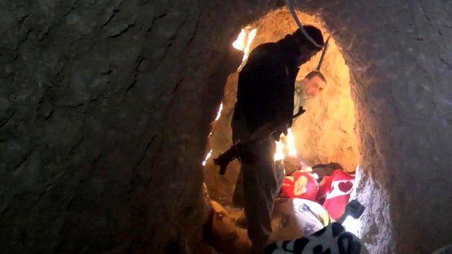 A man walks through an Islamic State tunnel