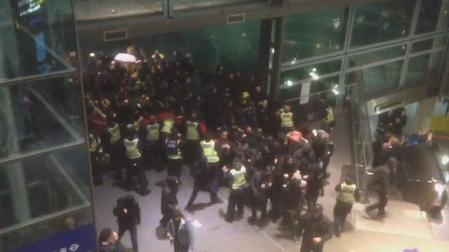 Police clash with protestors at St Pancras Station