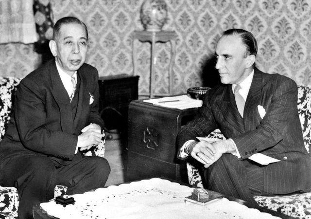 Japanese Prime Minister Nobusuke Kishi sits with US Ambassador to Japan Douglas MacArthur II