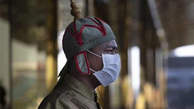 A Cambodian hotel guard wearing a mask stands outside the Nagaworld One hotel in Phnom Penh, Cambodia on February 12, 2020
