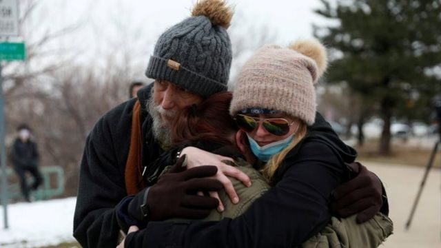 Sarah Moonshadow is comforted by David and Maggie Prowell after Moonshadow was inside King Soopers grocery store during a shooting in Boulder, Colorado, on 22 March 2021.