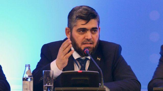 رئيس وفد المعارضة محمد علوش في مؤتمر صحفي عقب انتهاء محادثات أستانة