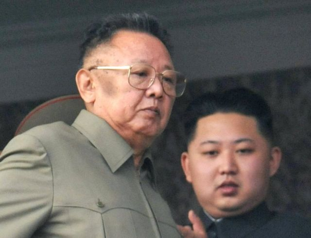 """North Korean leader Kim Jong-il (L) walks in front of his youngest son Kim Jong-un as they watch a parade to commemorate the 65th anniversary of the founding of the Workers"""" Party of Korea in Pyongyang in this October 10, 2010"""