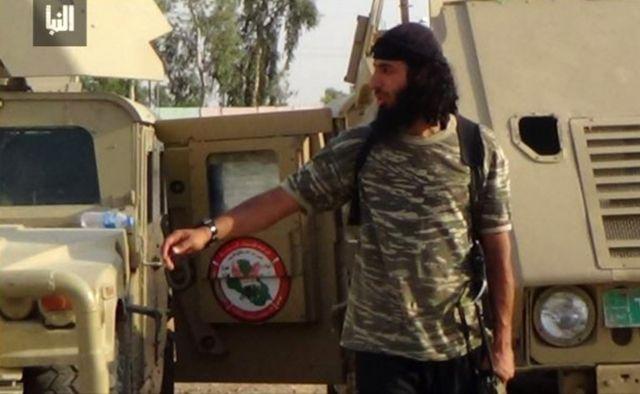 Undated image of Jihadi John seen outside a vehicle in a camouflage shirt