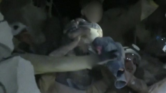 Child being pulled from rubble in Idlib, Syria.