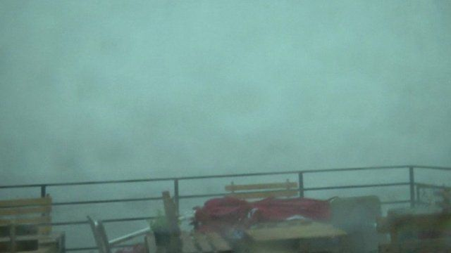 Still from amateur footage shows cafe being hit by Croatia storm