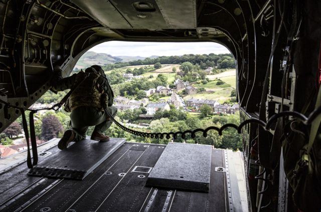 An RAF Chinook Mk6a helicopter approaches the Toddbrook Reservoir dam