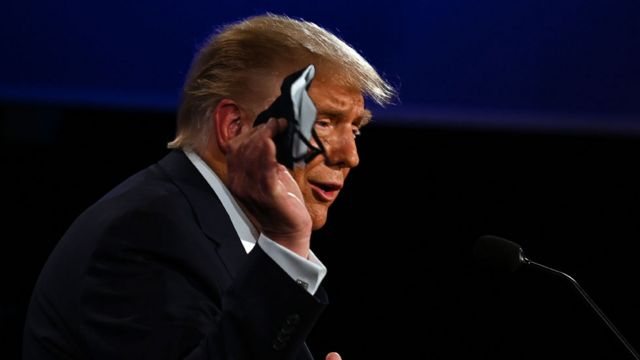 Trump holding mask