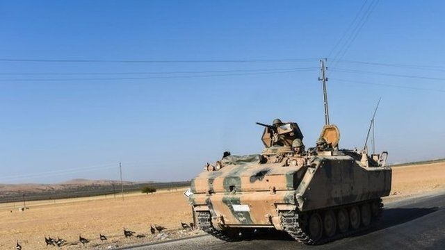 Tanks driving to Syria from Turkey