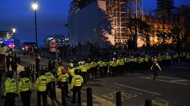 Police scuffle with protesters during a Black Lives Matter protest in central London