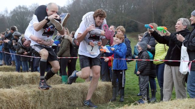 Competitors take part in the annual UK Wife Carrying Race
