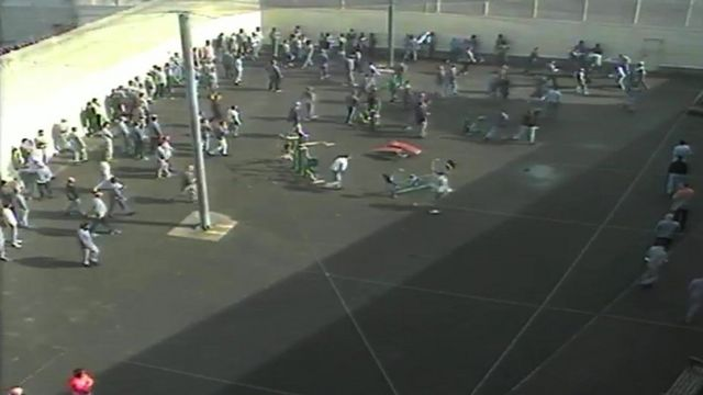 CCTV footage shows a fight at Wandsworth Prison in an exercise yard